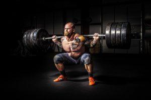 Bodybuilder Squating